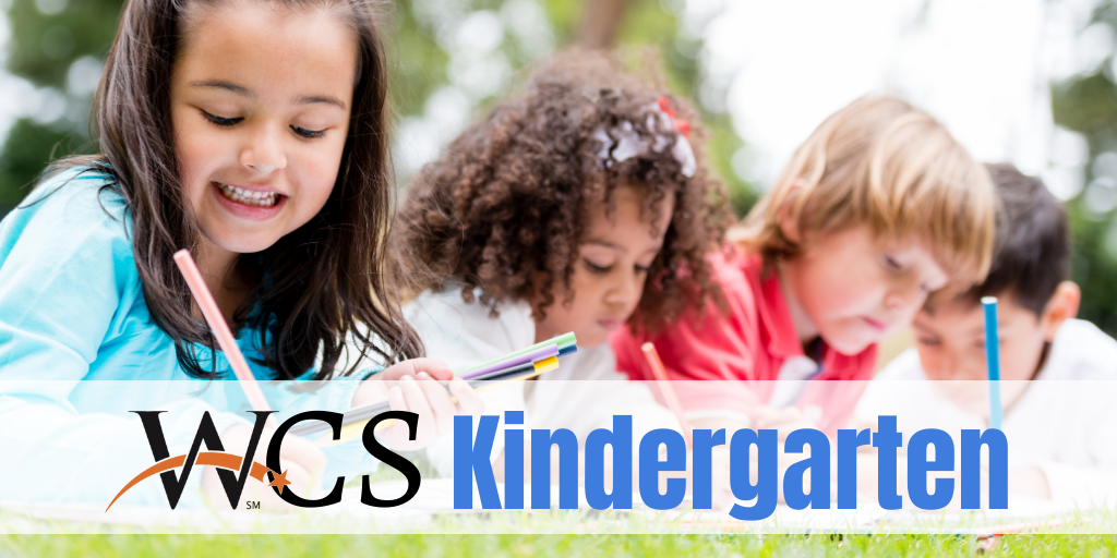 Children doing homework outside - link to Kindergarten enrollment page