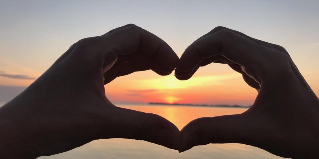 calm sunset heart hands